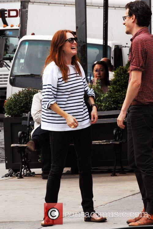Julianne Moore laughs with a friend after having...