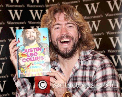 Signs copies of his book 'Good Times!' at...