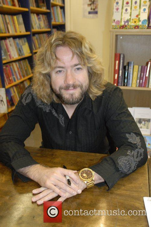Signing copies of his new book 'Good Times'