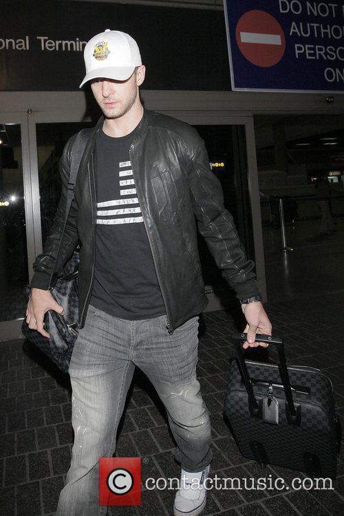 Justin Timberlake carrying his matching Louis Vuitton luggage...