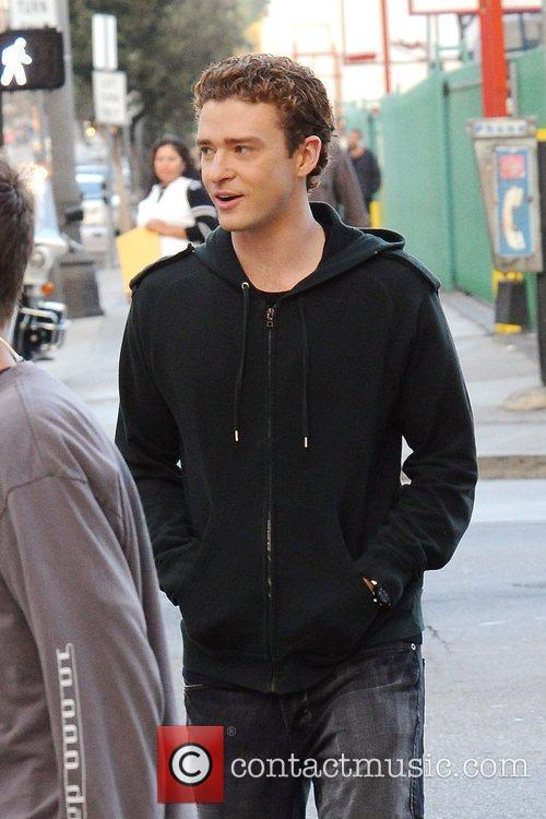 Justin Timberlake wearing all black, on his way...