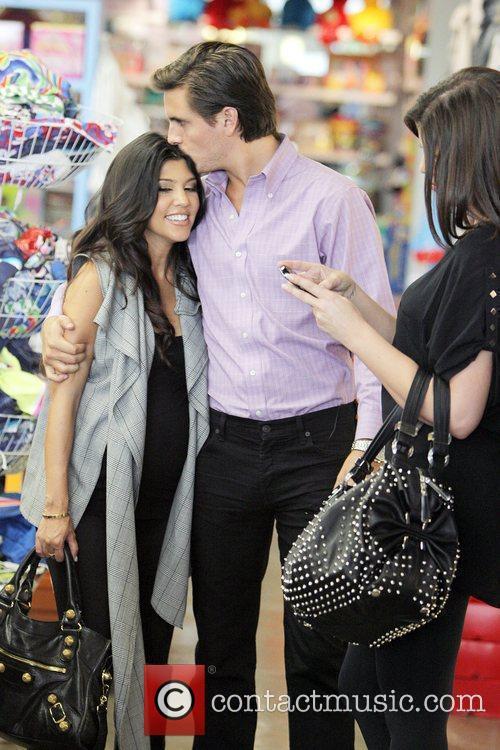 Khloe Kardashian, her pregnant sister, Kourtney Kardashian, and...