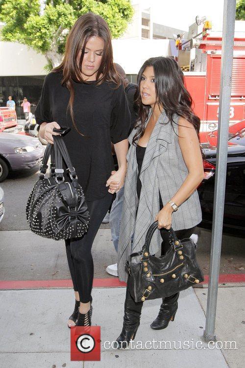 Pregnant Kourtney Kardashian shopping with her sister, Khloe...