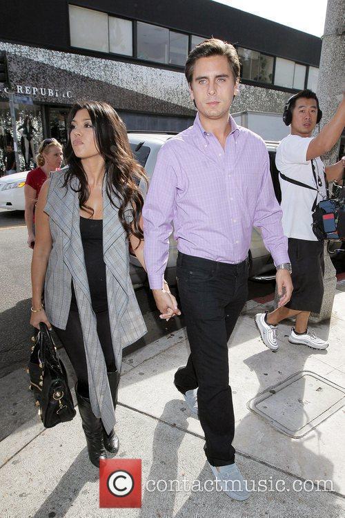 Pregnant Kourtney Kardashian shopping with her boyfriend, Scott...