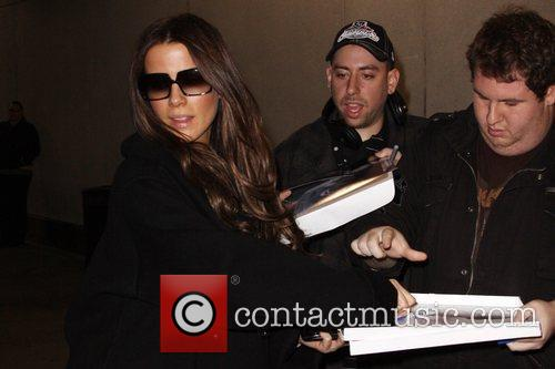 Kate Beckinsale signs autographs for fans as she...