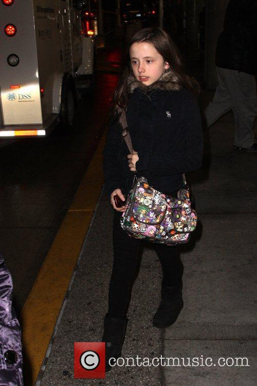 Arrives at JFK airport with her mother.