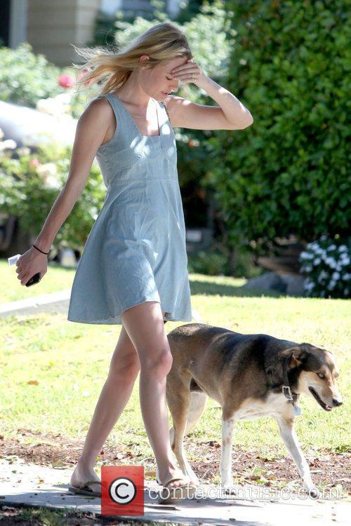 Kate Bosworth trying to shield her face while...