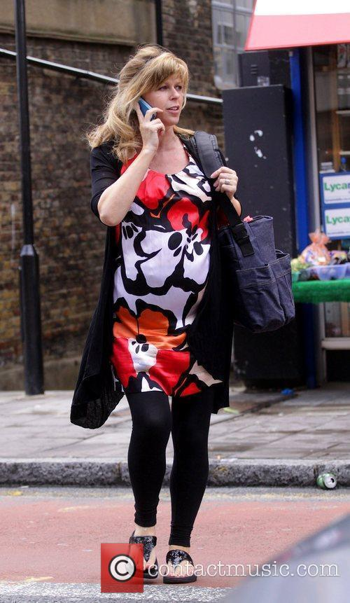 A heavily pregnant Kate Garraway crossing the street...