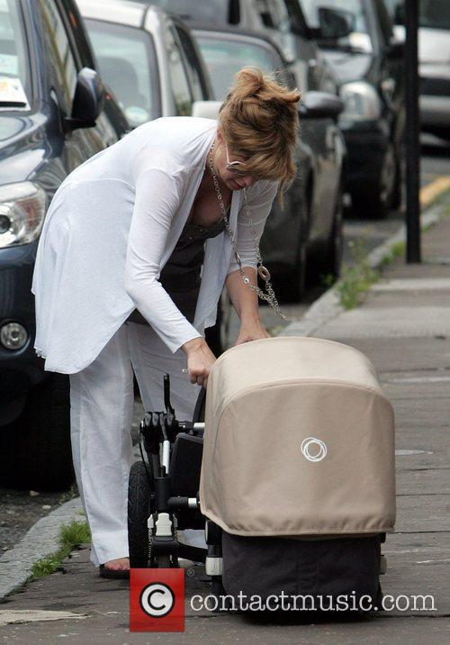 Assembles her pram, while she prepares to take...