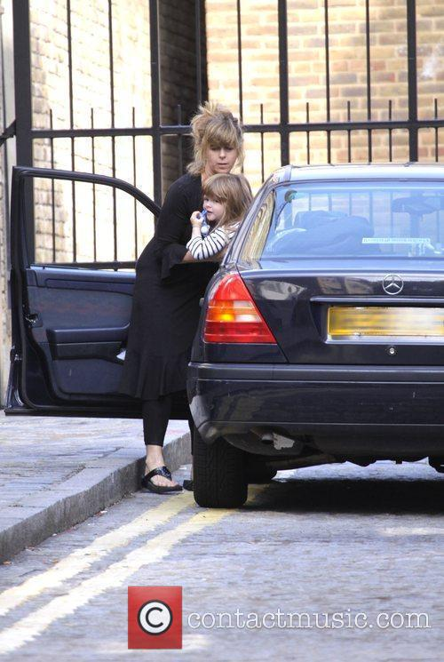 Kate Garraway returns home with her children Darcy...