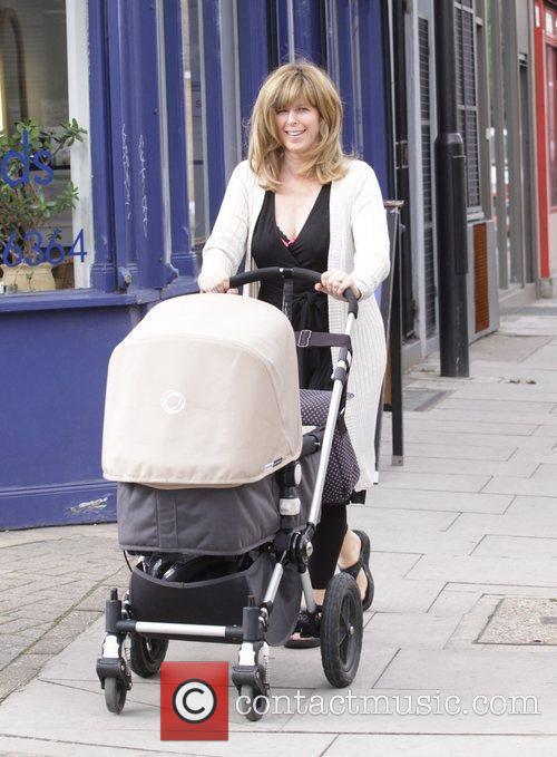 Puching her pram while leaving the hairdressers