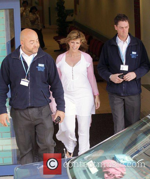 Leaving Imperial College hospital with her newborn son...