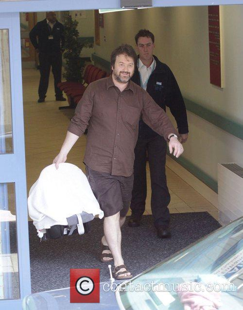 Leaving Imperial College hospital with his newborn son...
