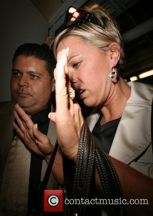 Kate Gosselin is greeted by a frenzy of...