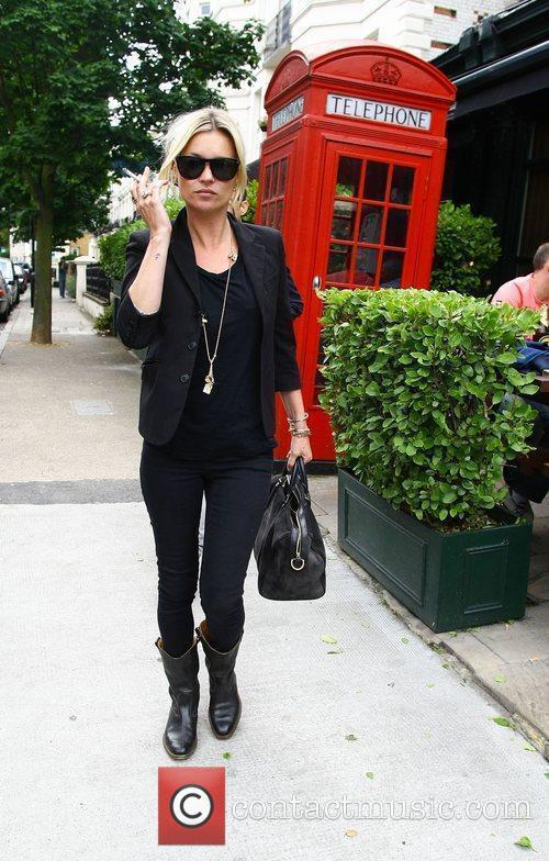 Kate Moss leaving a pub near her home...