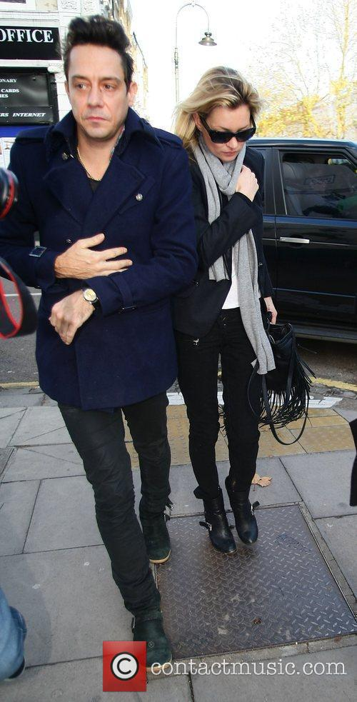 Kate Moss and Jamie Hince arriving at a...