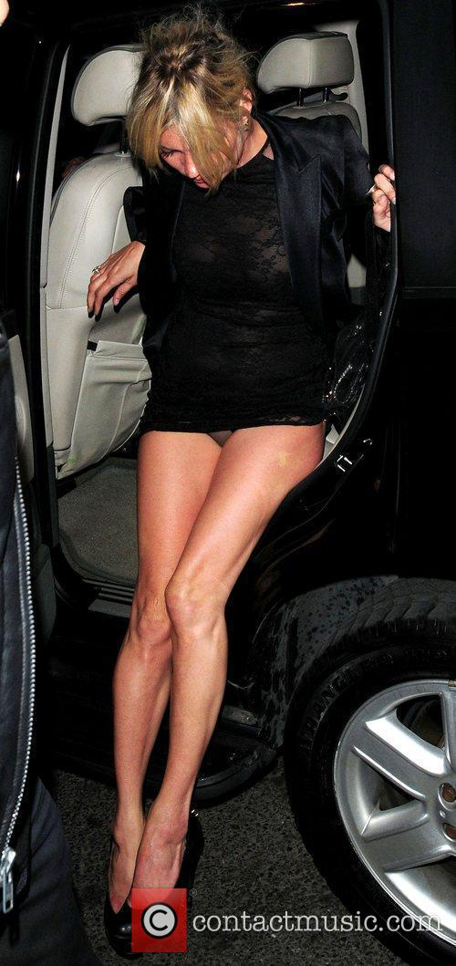 Kate Moss  reveals her underwear while getting...