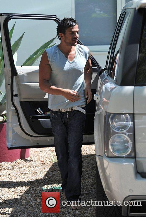 Peter Andre  outside his house as his...