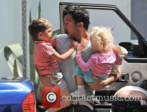 Peter Andre  with his children Junior and...
