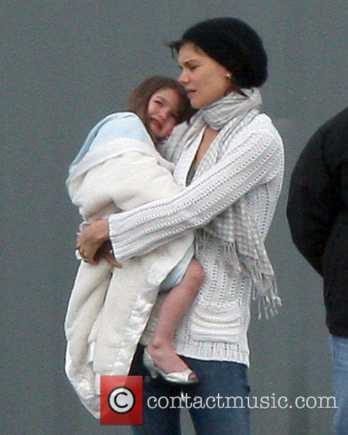Katie Holmes tries to cheer up her daughter,...