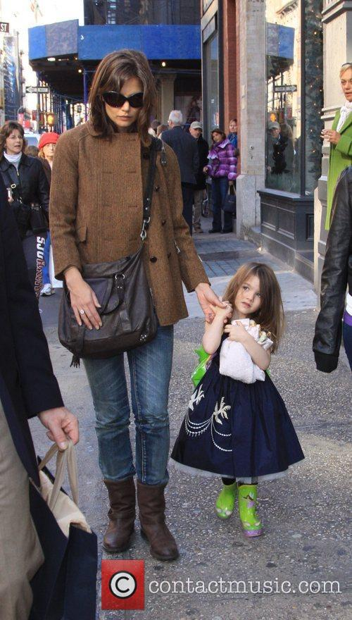 Katie Holmes, daughter Suri Cruise walking through New...