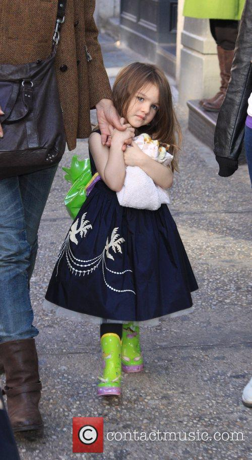 Suri Cruise  out with her mother and...