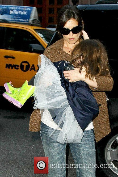 Katie Holmes and Suri Cruise Katie Holmes carrying...