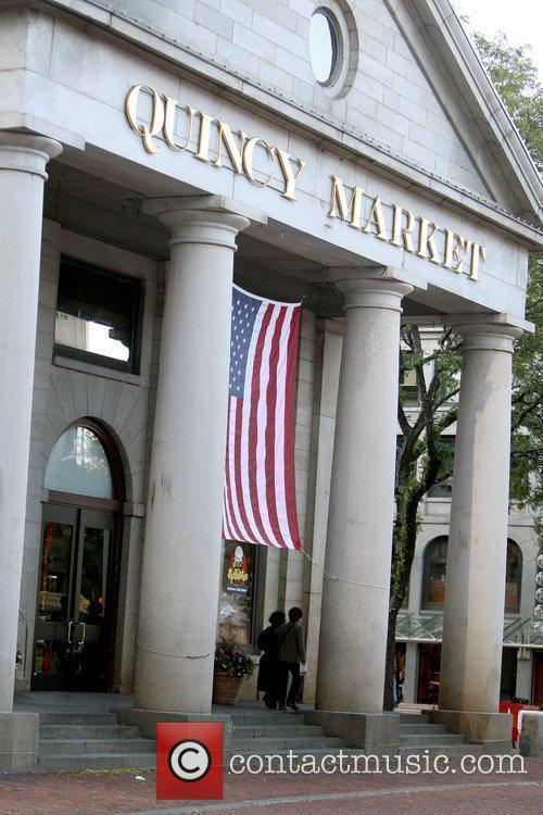 Katie Holmes shopping at Faneuil Hall Marketplace with...