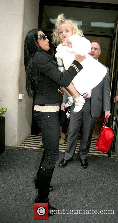 With her daughter Princess Tiaamii leaving her hotel.