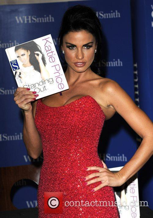 Signs copies of her new book 'Standing Out,...