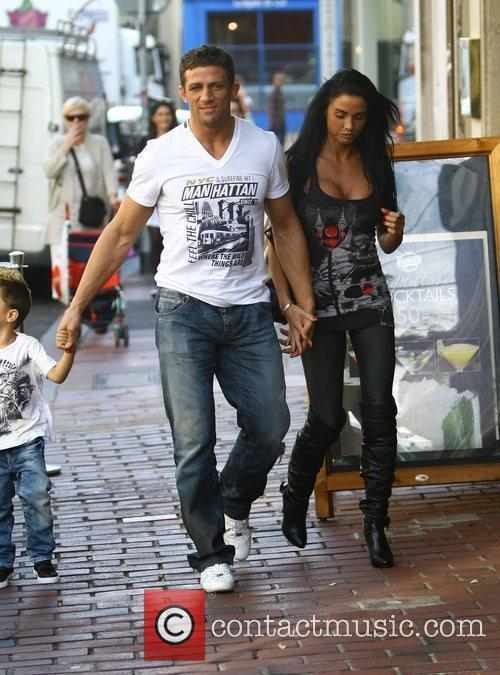 Katie Price, aka Jordan, with boyfriend Alex Reid and her son Junior 8