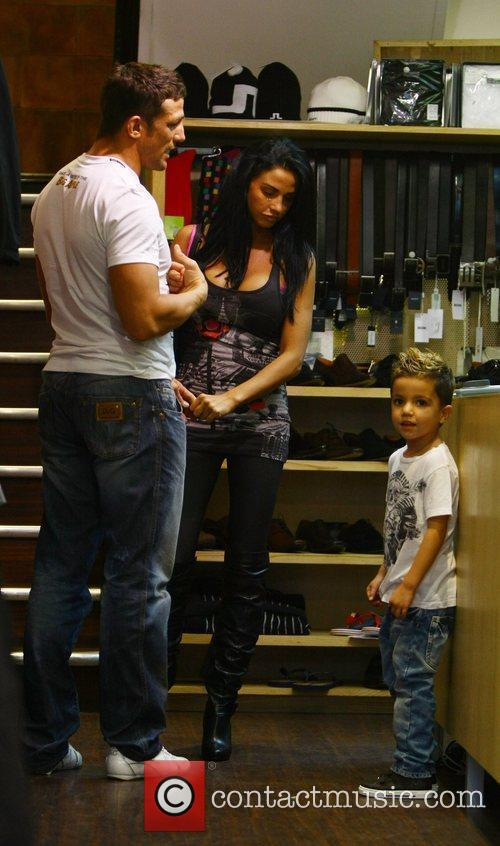 Katie Price, aka Jordan, with boyfriend Alex Reid and her son Junior 26