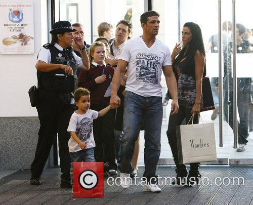 Katie Price, aka Jordan, with boyfriend Alex Reid and her son Junior 25