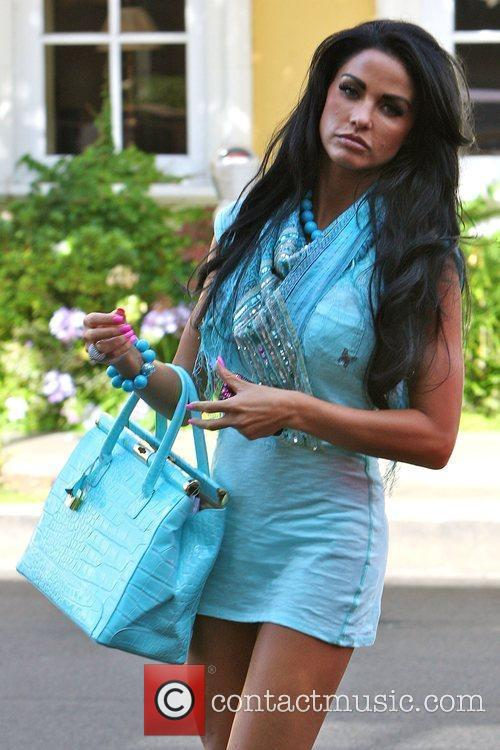 Katie Price, Aka Jordan, Carrying A Crocodile Handbag and Arrives At A Medical Building In Beverly Hills Wearing A Baby Blue Ensemble 10