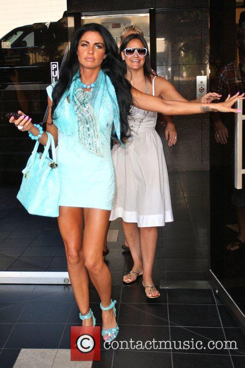 Katie Price, aka Jordan and leaving a medical building in Beverly Hills wearing a baby blue ensemble 5