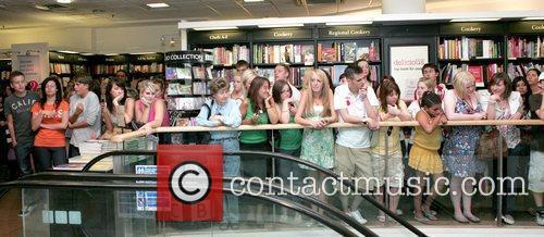 Atmosphere Katie Price AKA Jordan signing copies of...