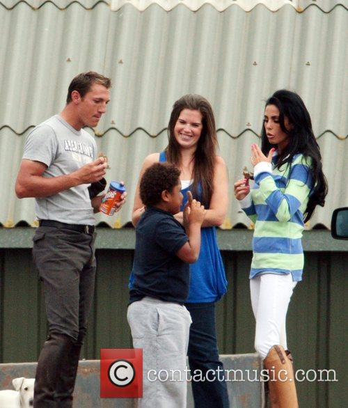 katie price aka jordan eating hobnobs at the stables with her riding instructor andrew gould 2480974