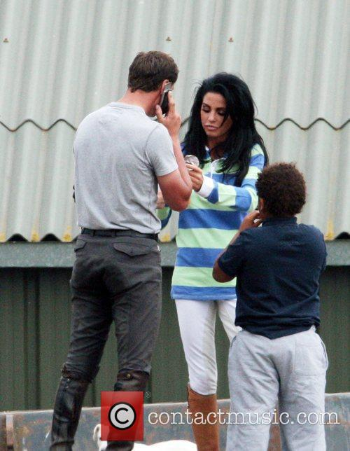 katie price aka jordan eating hobnobs at the stables with her riding instructor andrew gould 2480975