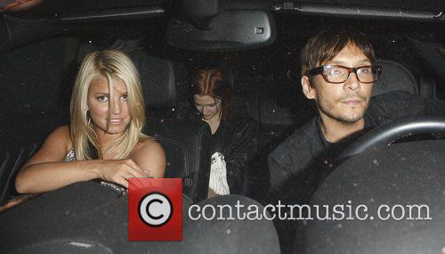Jessica Simpson and younger sister Ashlee Simpson-Wentz leaving...