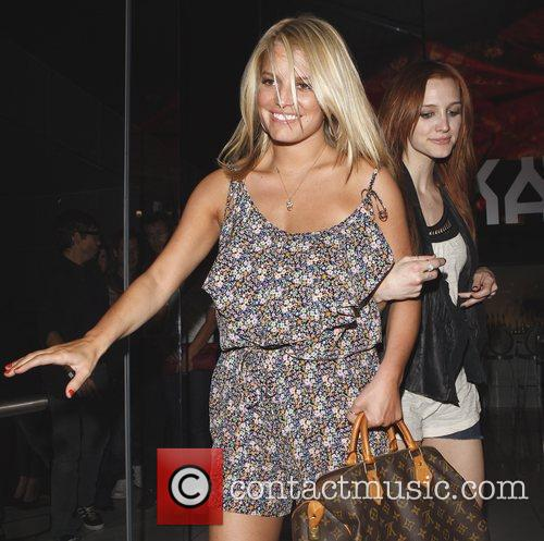 Jessica Simpson leads younger sister Ashlee Simpson-Wentz out...
