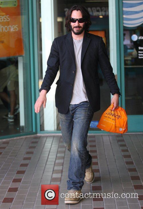 Keanu Reeves shopping at an AT&T store for...