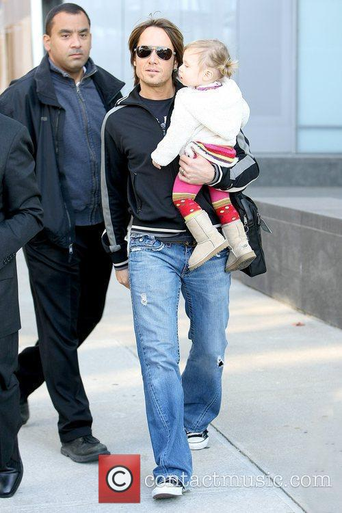 Leaving his Manhattan residence with his daughter, Sunday...