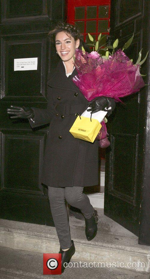 Kelly Brook  with a bouquet of flowers,...