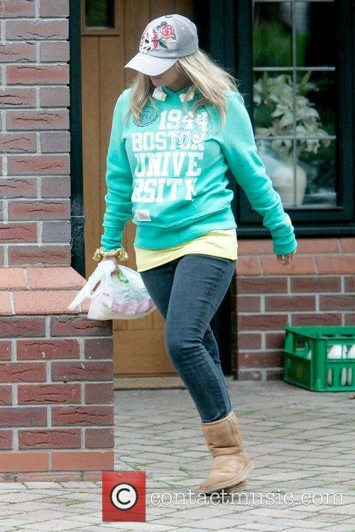 Kerry Katona leaves her home all covered up...