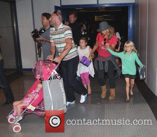 Mark Croft and Kerry Katona arrive back in...