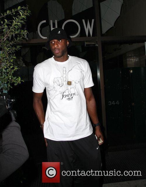 Lamar Odom leaving Mr Chow restaurant with his...