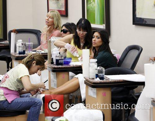Kim Kardashian getting a manicure and pedicure at...