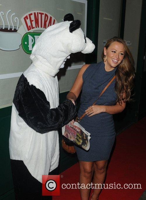 Greets a man in a Panda Costume at...