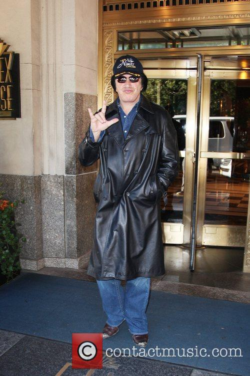 Gene Simmons of the band Kiss leaves his...