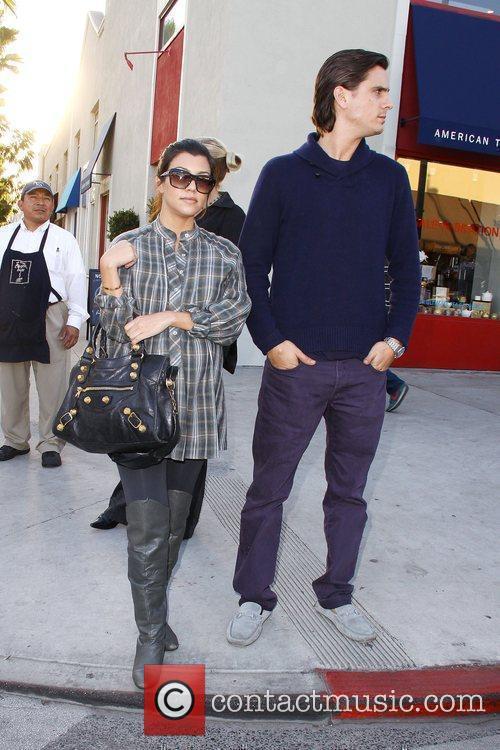 Pregnant Kourtney Kardashian and fiance Scott Disick out...